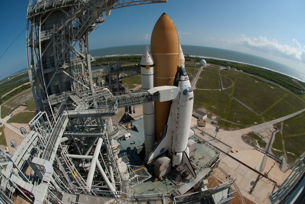 Space shuttle Discovery on launch pad for last time